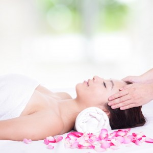 woman enjoy face and head massage at spa